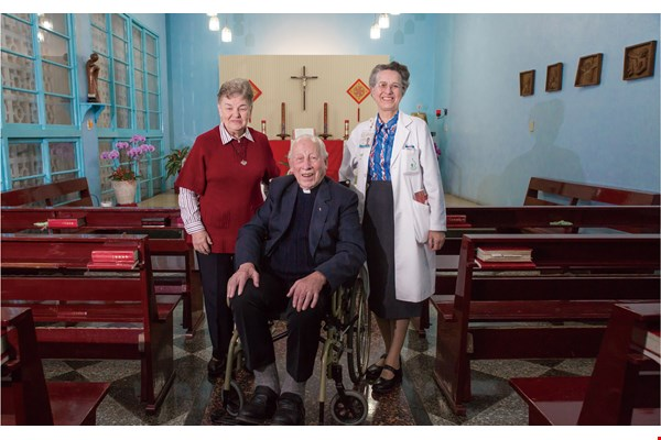 "The ""three treasures of St. Joseph's"" pose for a picture in the hospital's second-floor chapel. From left to right: Godelieve Franssens, Fr. Antoine Pierrot and Dr. Marguerite Billiet. (photo by Lin Min-hsuan)"
