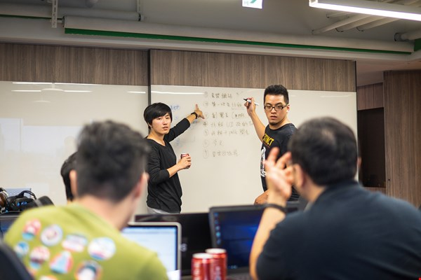 "The rise of g0v has encouraged more active civic participation in government, making government information more transparent and deepening democracy in Taiwan. In the photo, participants enthusiastically debate policy during a ""hackathon."""
