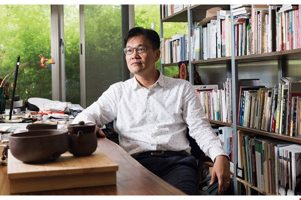 Hugh Hu considers traditional Chinese characters to be a precious aspect of Taiwan's cultural heritage.