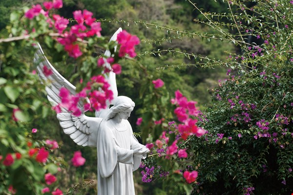 Outside the church, Martinson has put up a statue of an angel in memory of his mother Lily's love and tolerance, and her support for his calling to dedicate his life to service in Taiwan. (photo by Lin Min-hsuan)