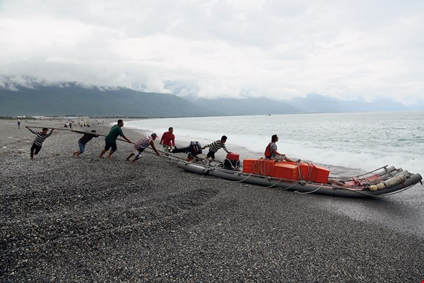 Fishermen prepare to set off on a pipe boat from Hualien's Qixingtan Beach to harvest fish from nearby fixed nets. This is a sustainable method of fishing.
