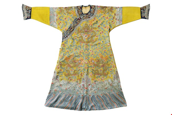 "Chen Cheng-hsiung has found new sources of artistic inspiration in different cultures, including the gentle beauty of Qing-Dynasty court apparel and the use of brilliant colors in Aboriginal art. The photo shows a Ming-Dynasty dragon robe in yellow silk brocade, embroidered with the auspicious ""12 Ornaments"" that symbolize imperial authority and power."