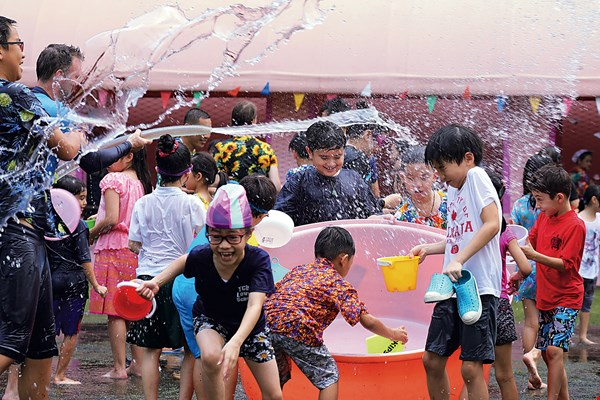 The Thai–Chinese International School joins the festivities for Songkran, the Thai new year festival.