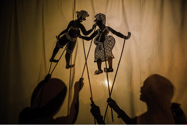 Cambodian shadow puppetry has a long history and is generally divided into two genres: Sbek Thom uses large puppets and deals with myths; Sbek Toch uses smaller puppets to tell folk tales.