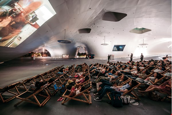 Weiwuying has also organized movie screenings that allow spectators to recline casually in Banyan Plaza while watching a movie projected onto the curved steel-plate wall.