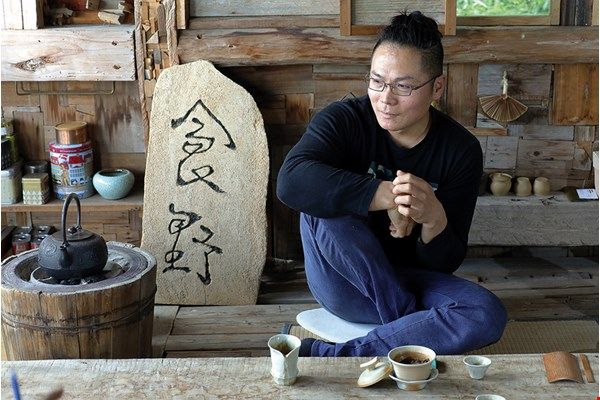 "Jian Jiawen lets his tea trees grow ""wild."" The tea brewed from their leaves is rich with the true flavor of the land."