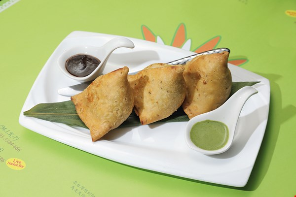 A must-eat Holi Festival treat: vegetarian curry puffs.