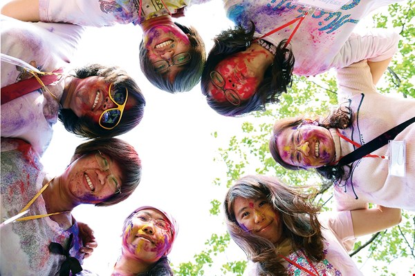 People of all ages sprinkle colored powders on one another during the Holi celebrations. (courtesy of Mayur Srivastava)