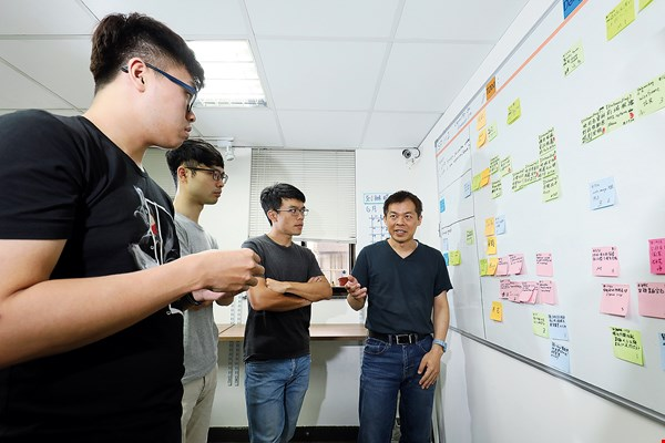 Rather than at a conference room table, meetings at  Junyi take place in front of whiteboards, where participants gather to brainstorm and  map out strategies using  sticky notes.