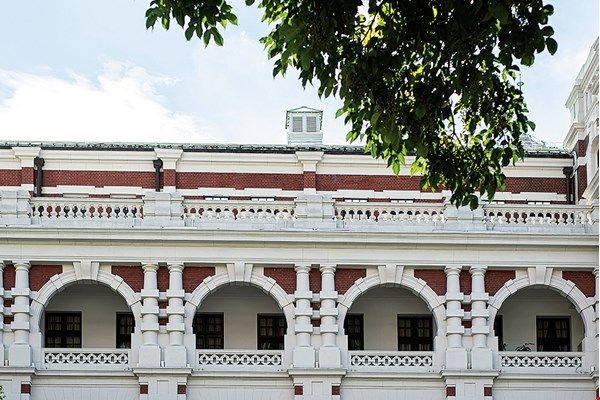 The century-old structure's arches and arcades, and the façade's alternating red and white ornamentation, are among the Presidential Office Building's most arresting features.