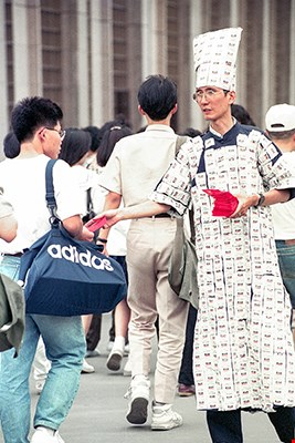 To promote AIDS prevention, Dayway Chief hung condoms all over himself and handed them out to passers-by. (© Central News Agency)