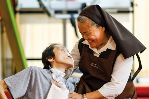 In Sister Mary's eyes, each child in the home is a precious gift from God. (photo by Chuang Kung-ju)