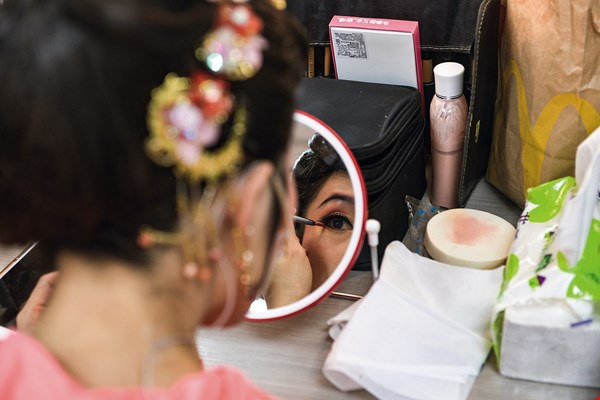 Hakka Grand Opera has its own cosmetic conventions; actors wear elaborate makeup.