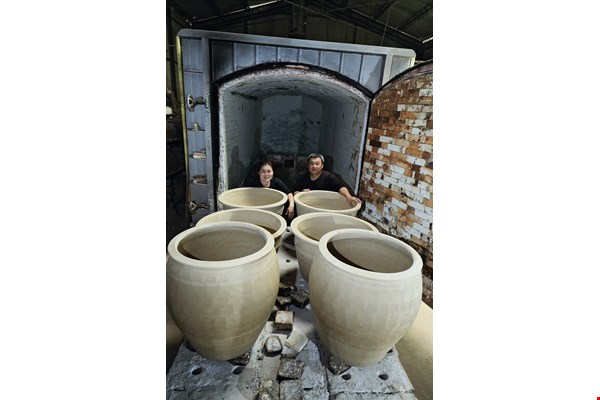 Traditional large urns are complicated to craft and easy to mess up, but despite having no formal training, Tjung Seha became a dab hand at making them.